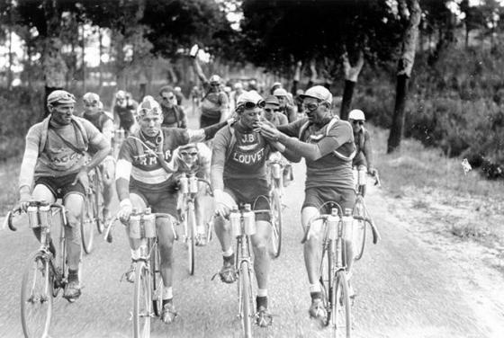 Smoking a cigarette while riding the Tour de France. 1920