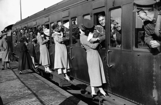 Soldiers departing for Egypt kiss their loved ones goodbye. London, 1935